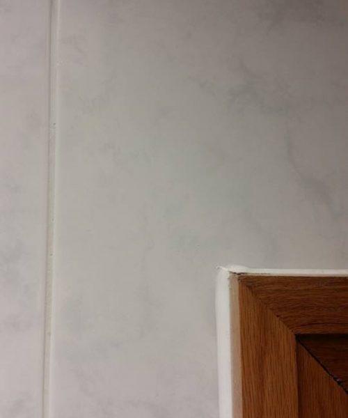 over door cracked tile repairs