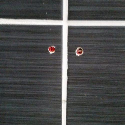 screw holes to tile repairs