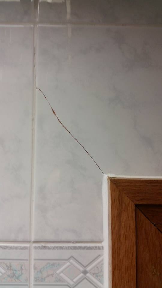 cracked wall tile repairs