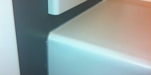 screw holes to cupboard unit repairs cracks to laminate surface repaired