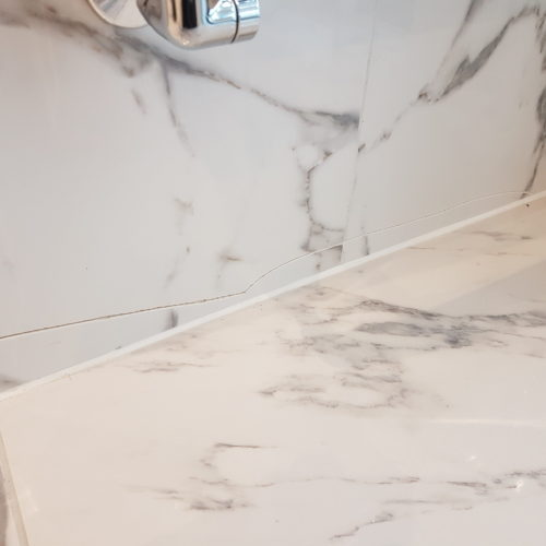 CRACKED GLOSS WALL TILE REPAIRS BEFORE