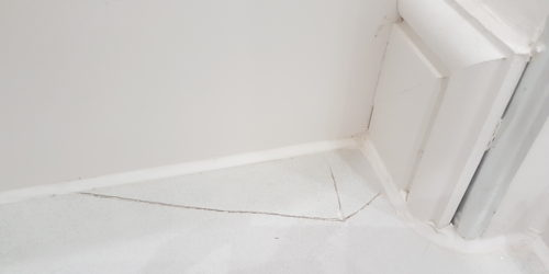 CRACKED BATHROOM TILE REPAIR BEFORE