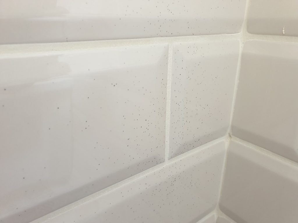 GRINDER SPLATTER TILE REPAIR BEFORE
