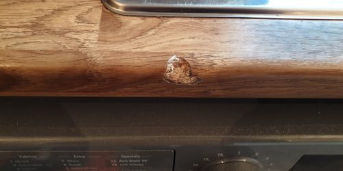 WOOD GRAIN EFFECT LAMINATE WORKTOP CHIP REPAIR MANCHESTER BEFORE