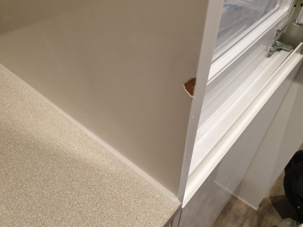 DAMAGED GLOSS WHITE KITCHEN END PANEL CHIP REPAIR CUPBOARD DOOR BEFORE