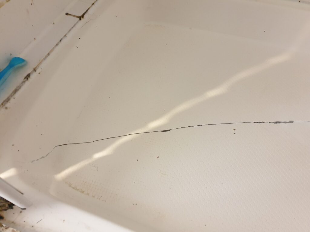 BADLY CRACKED SHOWER TRAY REPAIR BEFORE